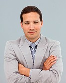 Young businessman with folded arms in front of the camera
