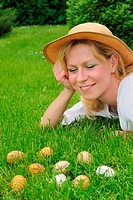 Young woman and easter eggs on the grass _ Easter time