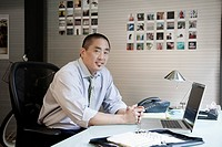 Pacific Islander businessman sitting at his desk