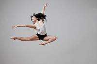 Graceful Caucasian ballet dancer in mid_air