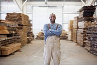 Black worker in lumber warehouse