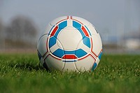Official soccer ball of the German Bundesliga, football lying on a grass field