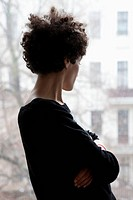 Side view of a woman looking through a window (thumbnail)