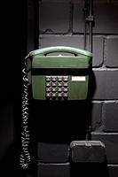 A old_fashioned telephone on a wall