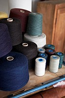 Spools of cotton on a workbench