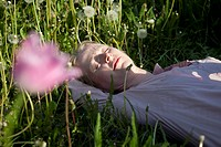 A woman lying in the grass sleeping, close_up