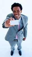 Smiling Afro_American businessman holding a business card
