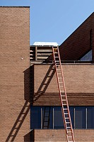 A ladder leaning against a building