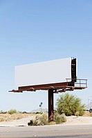 A blank billboard by a highway