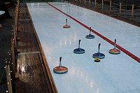 Curling stones on a curling sheet