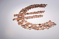 European Union coins arranged into a Euro symbol