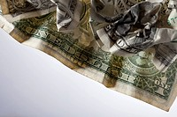Crumpled up dollar bills, close_up