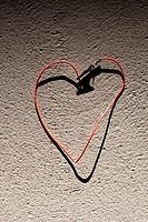 A red wire bent into the shape of heart