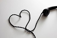 An old-fashioned telephone cord arranged into the shape of a heart (thumbnail)