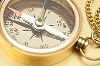 A brass pocket compass, close_up