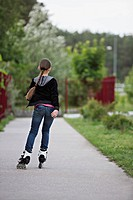 Rear view of a girl inline skating