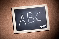 A small chalkboard with the letters, A, B and C handwritten on it