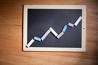 A line graph showing growth made with pieces of chalk and a chalkboard
