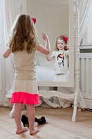 Girl admiring herself in mirror