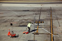 Ground crew preparing for jet landing