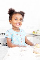 Smiling girl baking in kitchen