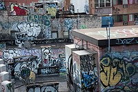 Graffiti covered tenement rooftop in Chinatown (thumbnail)