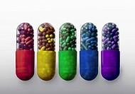 A row of vibrantly variously colored capsule pills, close_up