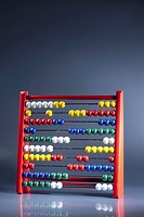 An abacus with multi colored wooden beads