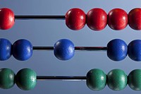 The red, blue and green beads of an abacus, close_up