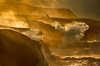 Waves crashing on rocky cliffs