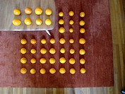 Forced perspective of rows of tangerines