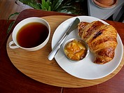 Tea, croissant and marmalade
