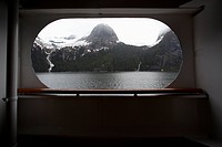 View of Tracy Arm fjord through the window of a passenger ship, Alaska