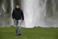 Man walking in grassy field