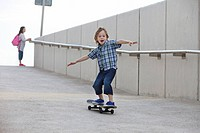 Boy riding skateboard on ramp