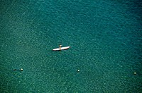 Person rowing on paddleboard on the sea