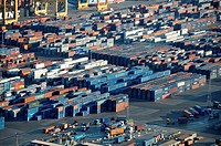 Lorries loading cargo containers at the docks in Barcelona, Spain