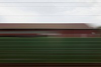 A building and abstract pattern in blurred motion viewed from moving train