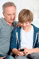Father and son playing with mobile phone