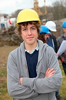 Portrait of teenager with security helmet