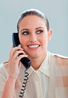 Attractive businesswoman talking on phone