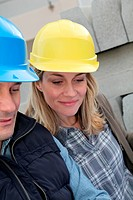 Closeup of architects with security helmets