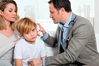 Doctor cheking little boy´s ear infection