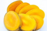 Cutting mangoes in a plate