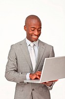 Afro_American businessman using a laptop