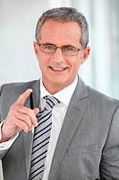 Portrait of mature businessman with eyeglasses