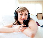 Portrait of an attractive woman listening the music with headphones