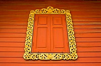 Ancient Golden carving wooden window of Thai temple in Bangkok, Thailand