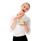 Young businesswoman eating salad