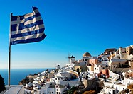 Oia scenery with Greece flag